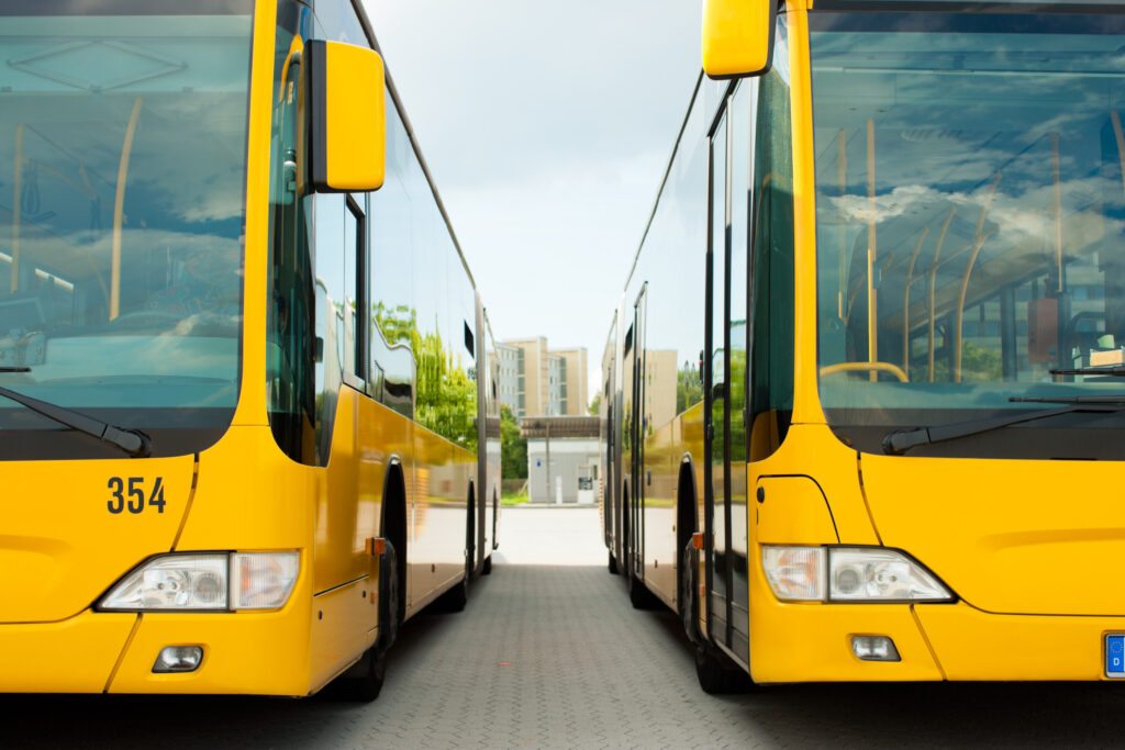 Two yellow low-floor buses